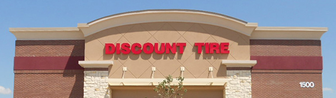 Close-up of Discount Tire signs