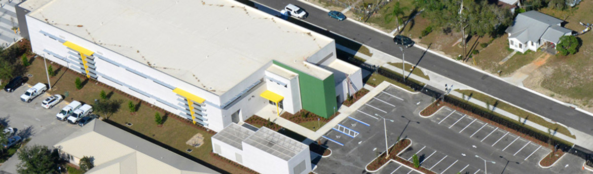 Aerial view of entire building and parking lot