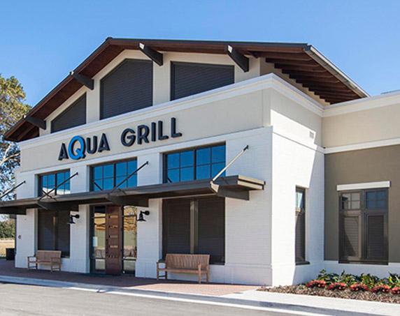 Exterior view of Aqua Grill building at Sawgrass Villages