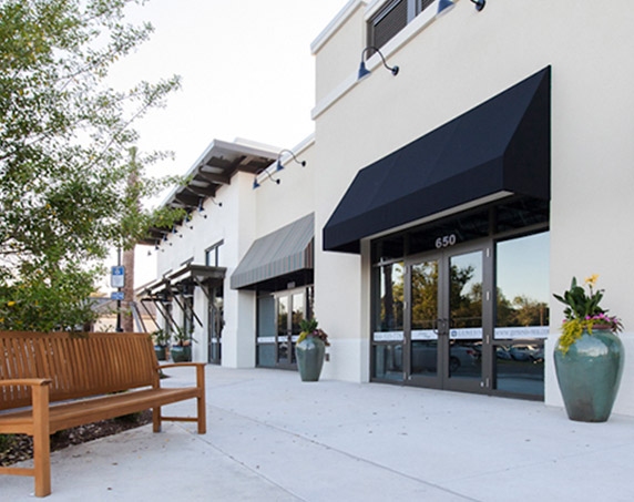 Shop and sidewalk seating view at Sawgrass Villages