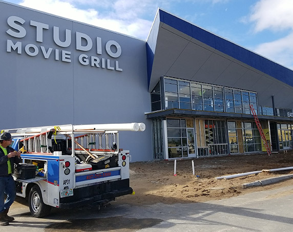 Exterior view of Studio Movie Grill during construction