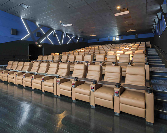 Comfortable seating in movie theater at Studio Movie Grill