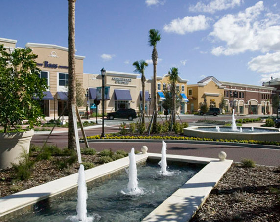 Multiple storefronts with water feature at Winder Garden Village