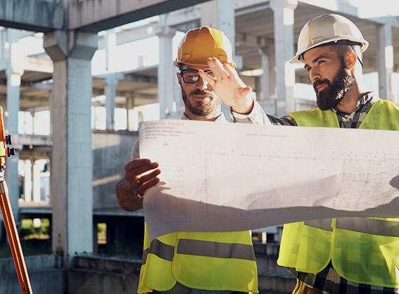 Construction management team looking at blueprints